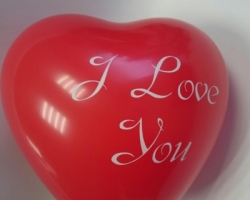 Red heart shapped balloon with print I love you