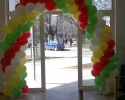 arch of balloons in white yellow red and green