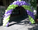 arch of balloons in purple and green color