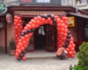 arch of balloons in red and black color