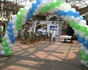 arch of balloons in white blue and green