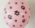 Pink ballon with print paws