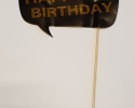 Happy birthday sign in black and gold